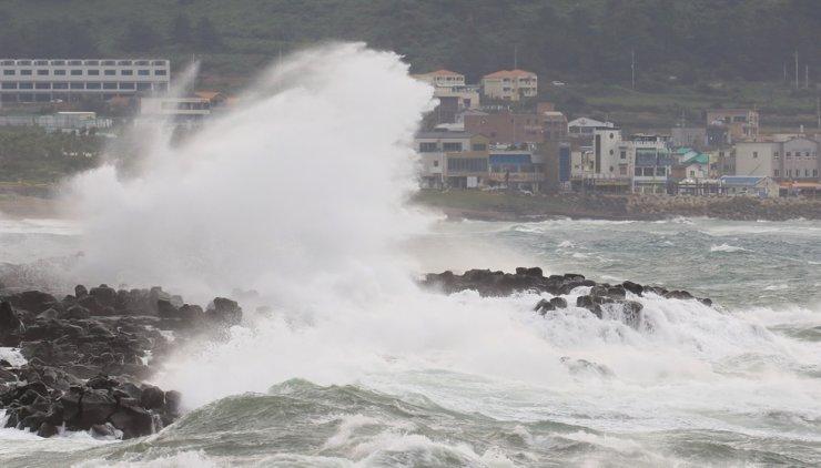 Waves hit the rocks near the beach in Seogwipo, southern Jeju. Yonhap