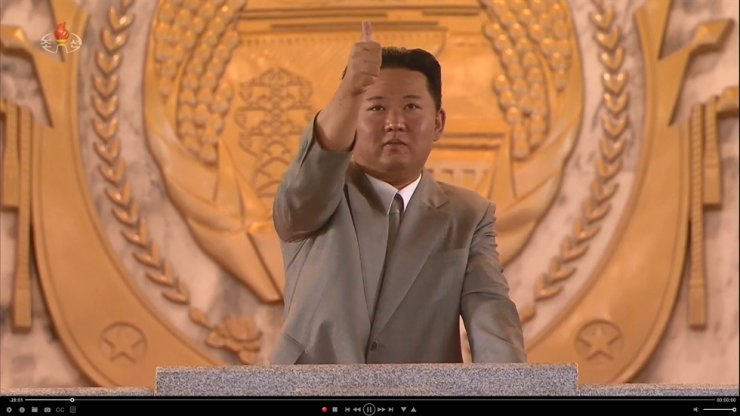 North Korean leader Kim Jong-un gives a thumbs-up while watching a military parade at Kim Il-sung Square in Pyongyang, Thursday, to celebrate the 73rd anniversary of the country's founding. Yonhap
