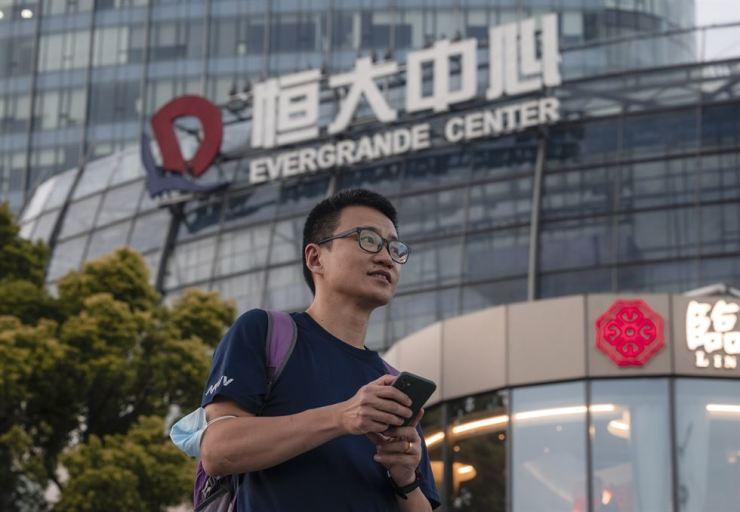 A man walks past the Evergrande Center in Shanghai, China, Tuesday. EPA-Yonhap