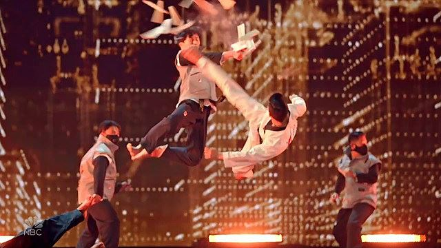 A member of the World Taekwondo demonstration team jumps up to break wooden boards during the finals of 'America's Got Talent.' Courtesy of World Taekwondo