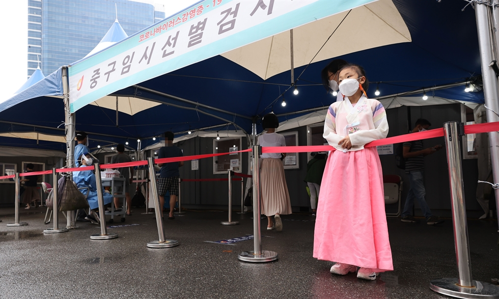 A woman gets tested for COVID-19 at a testing center in Seoul Station, Sept. 20. Yonhap