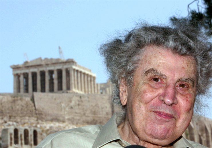 In this 2004 June file photo, Greek composer Mikis Theodorakis attends a press conference in front of the landmark Acropolis hill in backround, in Athens, Greece. EPA-Yonhap
