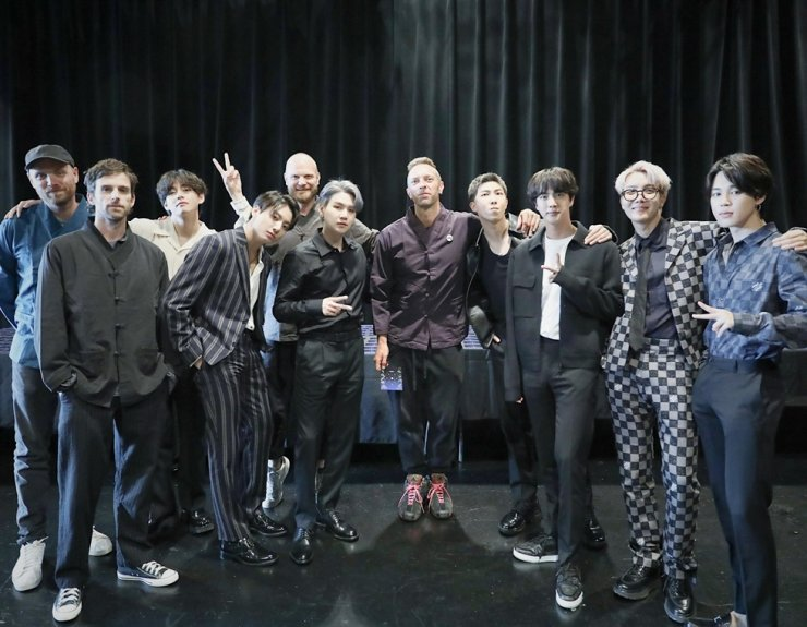 This photo from BTS' Twitter account shows the K-pop band with British rock band Coldplay in New York. Yonhap
