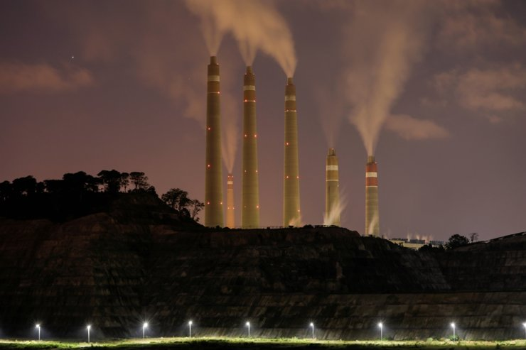Smoke and steam billow from a coal-fired power plant owned by Indonesia Power, next to an area for the Java 9 and 10 Coal-Fired Steam Power Plant Project, in Suralaya, Banten Province, Indonesia, July 11, 2020. Reuters-Yonhap