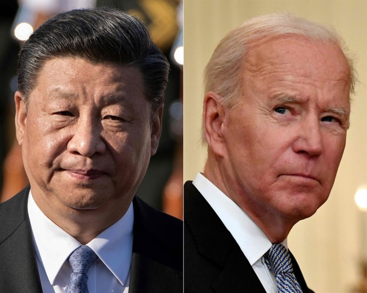 In this file combination of pictures created on June 8 shows Chinese President Xi Jinping, left, and U.S. President Joe Biden. The leaders of the world's two biggest economies 'conducted candid, in-depth and extensive strategic communication and exchanges on China-U.S. relations and issues of mutual concern,' state broadcaster CCTV said. AFP-Yonhap