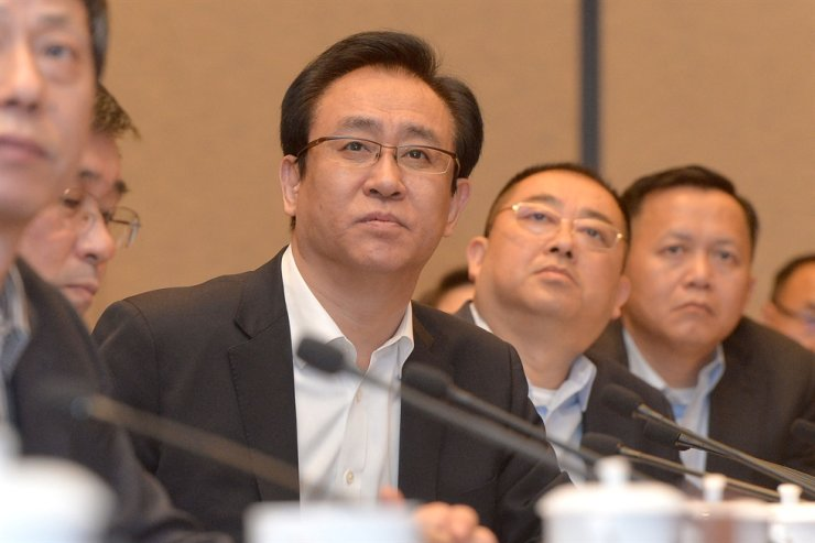 This photo shows Evergrande's president Xu Jiayin, also known as Hui Ka Yan in Cantonese, attending a meeting in Wuhan, in China's central Hubei province in June, 2017. AFP-Yonhap