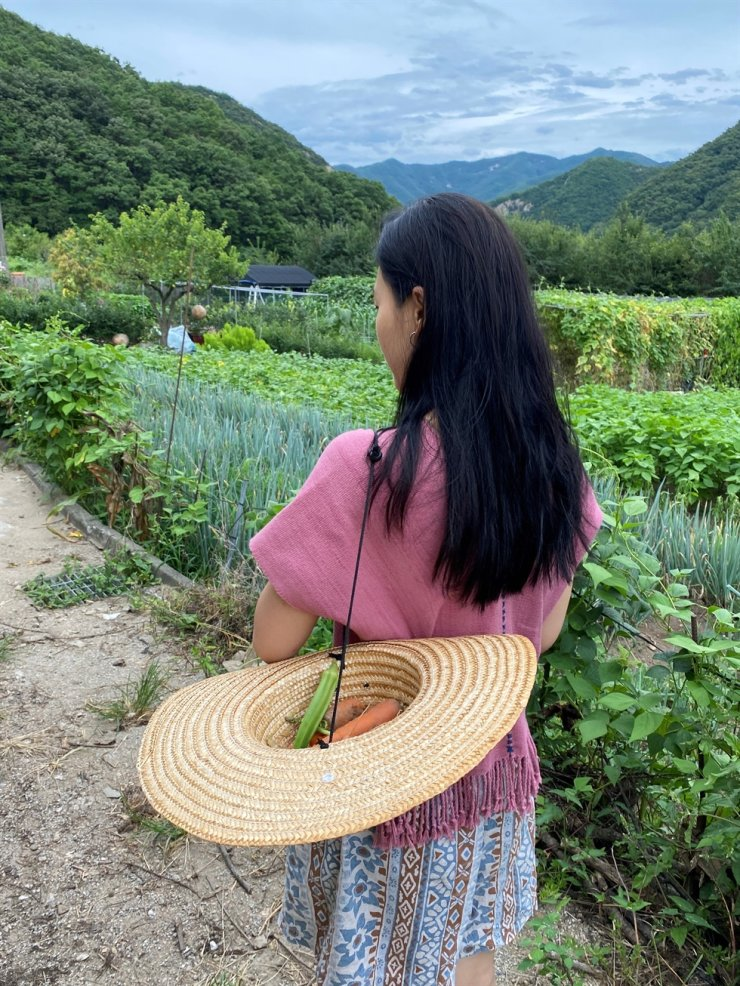 Park So-yeon heads back inside after gathering some vegetables near Mount Gyeryong on Aug. 8. Courtesy of Park So-yeon