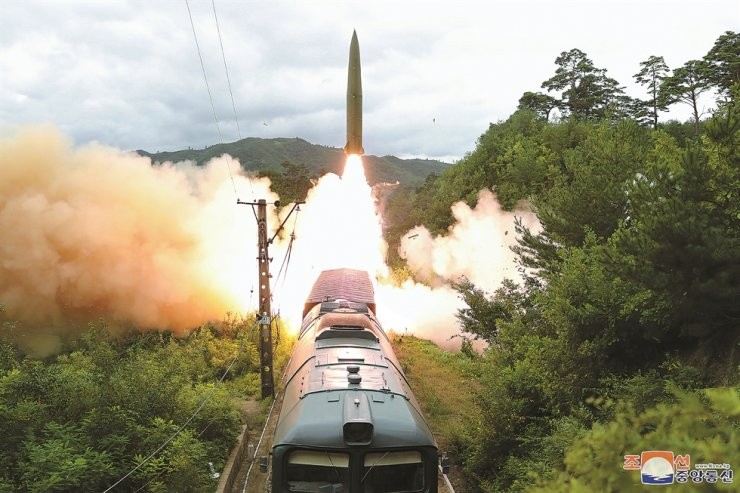 North Korea launches a short-range ballistic missile from a train during a live-fire exercise in a central mountainous area of the country, in this photo released by the North's Korean Central News Agency, Thursday. The country launched two ballistic missiles into waters off its east coast, Wednesday, a violation of multiple United Nations Security Council resolutions. Yonhap