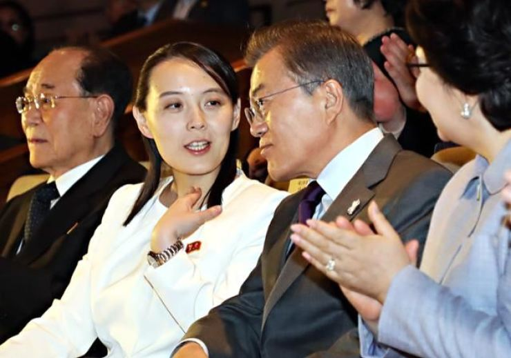 President Moon Jae-in listens to Kim Yo-jong, sister of North Korea's leader Kim Jong-un, during a performance of North Korea's Samjiyon Band at a theater in Seoul, Feb. 11, 2018. Korea Times photo by Koh Young-kwon