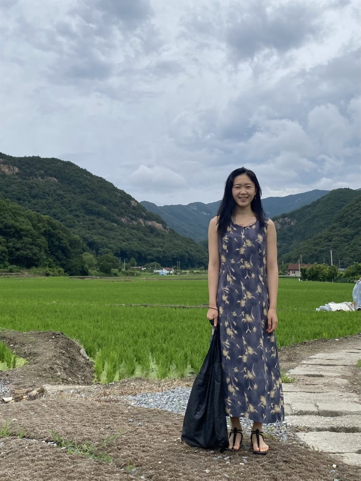 Park So-yeon, a 28-year-old Seoul resident and yoga instructor, poses near Mount Gyeryong in South Chungcheong Province on July 16. Courtesy of Park So-yeon