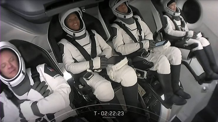 This screengrab taken from the SpaceX live webcast shows crew members, from right, Hayley Arceneaux, Jared Isaacman, Sian Proctor and Christopher Sembroski after being buckled into their seats in the Crew Dragon capsule ahead of the launch of the Inspiration4 at NASA's Kennedy Space Center in Fla., Sept. 15. AFP-Yonhap