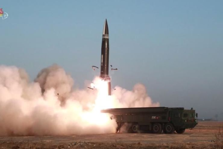 A new type of tactical guided missile is launched from the North Korean town of Hamju, South Hamgyong Province, March 25. Korea Times file