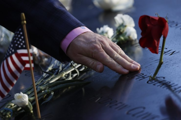 A person touches the name of a victim on the 9/11 Memorial on the 20th anniversary of the September 11 attacks in Manhattan, New York City, USA, Sept. 11. EPA-Yonhap