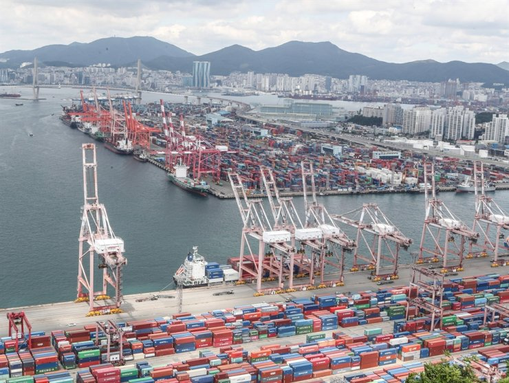 Containers are stacked for exports in the port of Busan, in this May 21 file photo. Yonhap