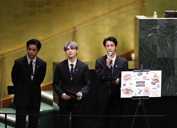 Members of of K-pop band BTS, from left, V, Suga and Jin appear at the United Nations meeting on Sustainable Development Goals during the 76th session of the U.N. General Assembly, at U.N. headquarters, Sept. 20. AP-Yonhap
