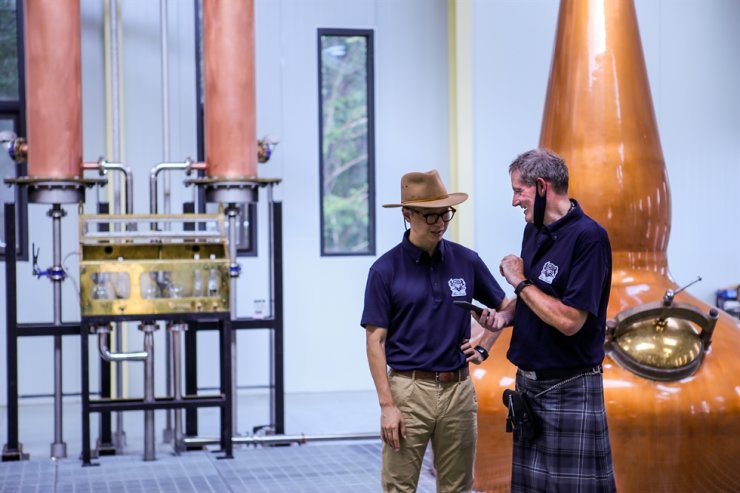 Bryan Do, left, and Andrew Shand stand in the distillery, Namyangju, Gyeonggi Province. Courtesy of Three Societies