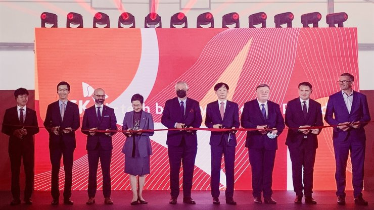 Export-Import Bank of Korea (Eximbank) CEO Bang Moon-kyu, second from left, cuts a ribbon with Poland's Deputy Minister of Economic Development, Labor and Technology Grzegorz Piechowiak, center, SKIET CEO Rho Jae-sok, fourth from right, and other participants, during a ceremony to celebrate the completion of SKIET's battery separator plant construction in Katowice, Poland, Wednesday. The state-run bank loaned 260 billion won ($218 million) to the battery material maker's Polish subsidiary in 2019. Courtesy of Eximbank