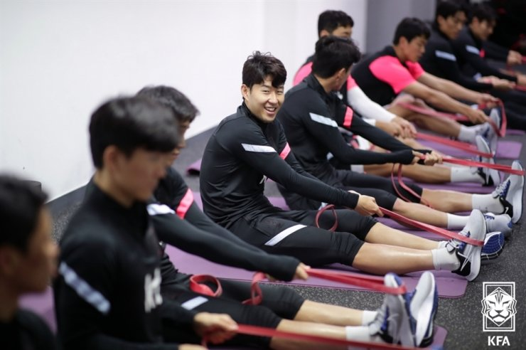 Korea's national football team forward Son Heung-min, center, smiles during the team's recovery training session at the Paju National Football Center in Gyeonggi Province, Oct. 8. Courtesy of the Korea Football Association