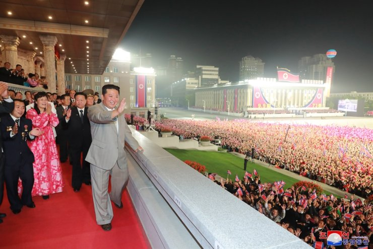 In this photo released by North Korea's official Korean Central News Agency, North Korean leader Kim Jong-un waves to the crowd during a military parade at Kim Il-sung Square in Pyongyang, Sept. 9, to celebrate the 73rd anniversary of the country's founding. Yonhap