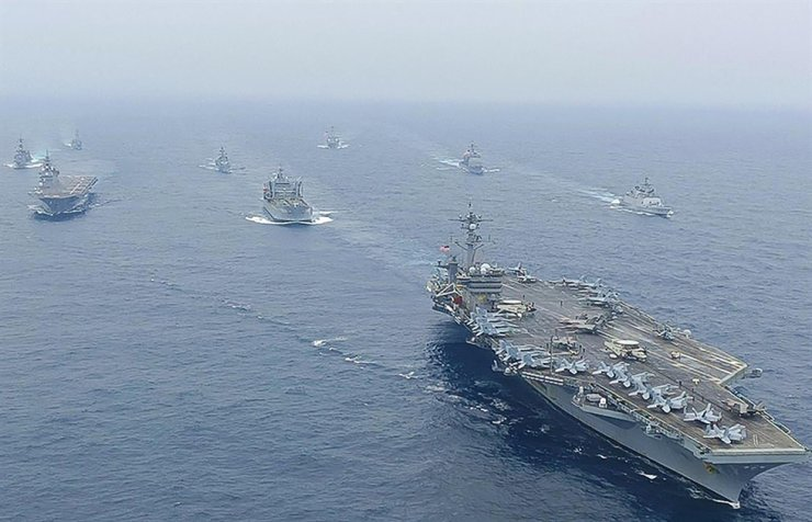 This handout photo released by the Indian Navy on October 12, 2020 shows ships during the second phase of the Malabar naval exercise in which India, Australia, Japan and the U.S are taking part in the Bay of Bengal in the Indian Ocean. AFP-Yonhap