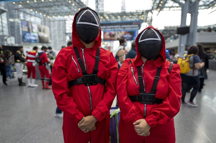 Attendees dressed as characters from 'Squid Game' pose during New York Comic Con at the Jacob K. Javits Convention Center, Oct. 8, in New York. AP-Yonhap