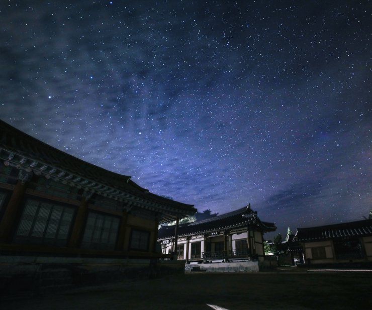 The buildings of Sosu Seowon are seen under a starlit sky. Courtesy of Korea Tourism Organization
