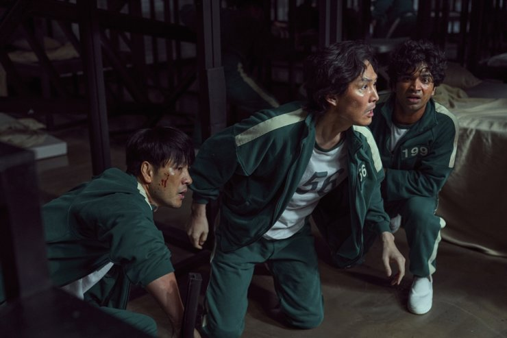 This undated photo released by Netflix shows South Korean cast members, from left, Park Hae-soo, Lee Jung-jae and Anupam Tripathi in a scene from 'Squid Game.' Netflix via AP-Yonhap