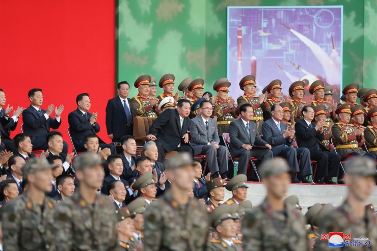 North Korean leader Kim Jong-un watches the opening ceremony of a defense development exhibition on the 76th founding anniversary of the ruling Workers' Party, Oct. 11. Yonhap