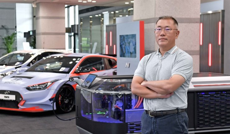 Hyundai Motor Group Chairman Chung Euisun poses with Hyundai Motor's high-performance cars in this photo provided by the group, Monday. Courtesy of Hyundai Motor Group
