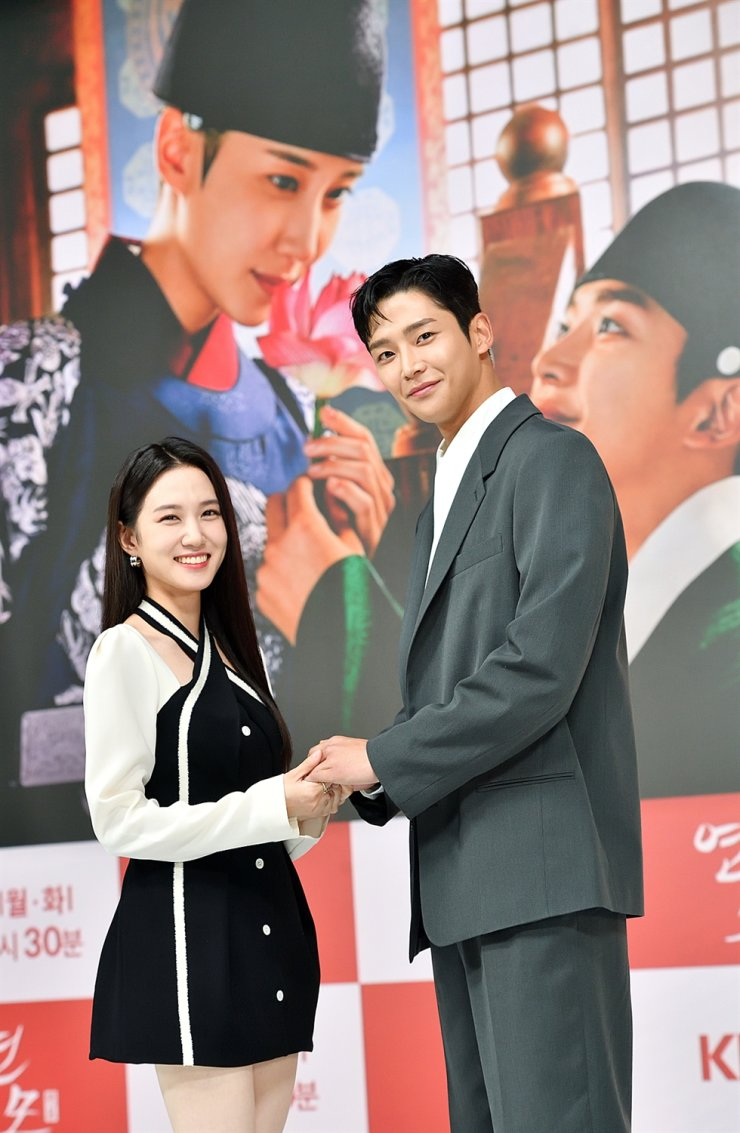 Actors Park Eun-bin, left, and Rowoon pose for pictures during the online press conference for the series, 'The King's Affection,' last Friday. Courtesy of KBS
