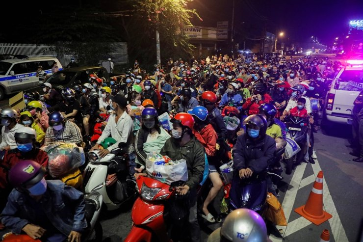 People wait at a checkpoint to leave Ho Chi Minh City, Vietnam, Sept. 30. Reuters-Yonhap