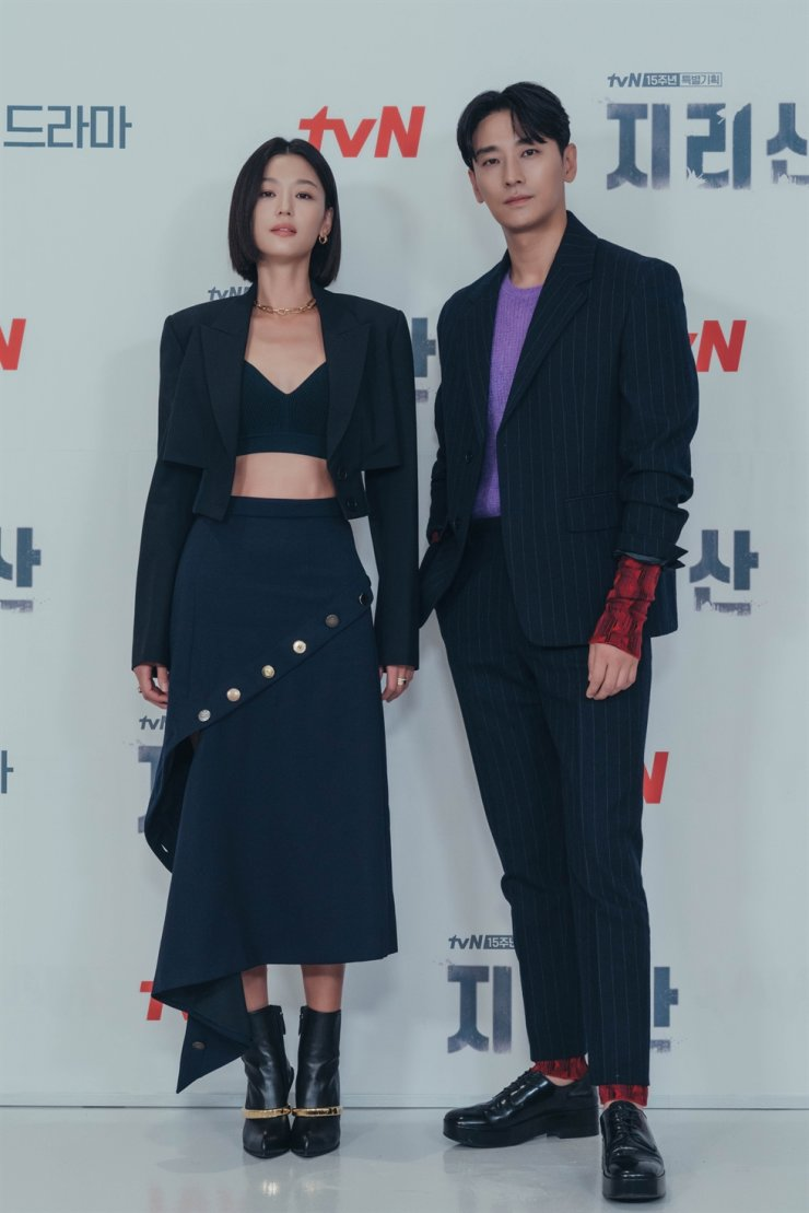 Actors Jun Ji-hyun, left, and Ju Ji-hoon pose for pictures during the online press conference of the new series, 'Jirisan', Wednesday. Courtesy of tvN