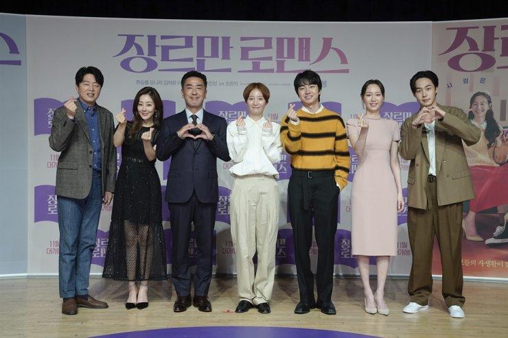 Director Cho Eun-ji, center, poses with the cast of