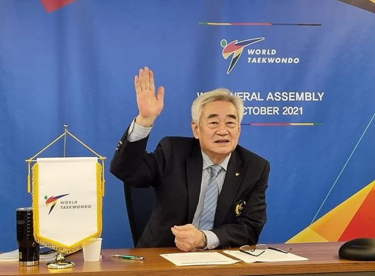 World Taekwondo President Choue Chung-won raises his hand after getting reelected as the chief of the international governing body of the sport, Oct. 11. Courtesy of World Taekwondo