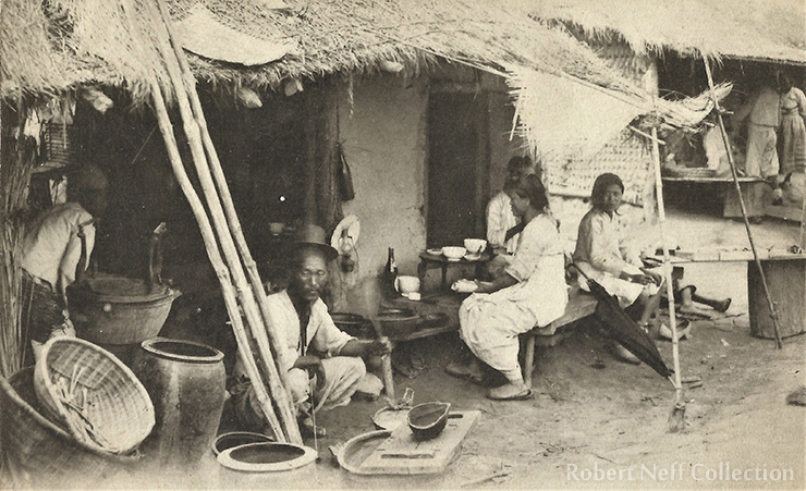 A young man eating his dinner in the early 1900s / Robert Neff Collection