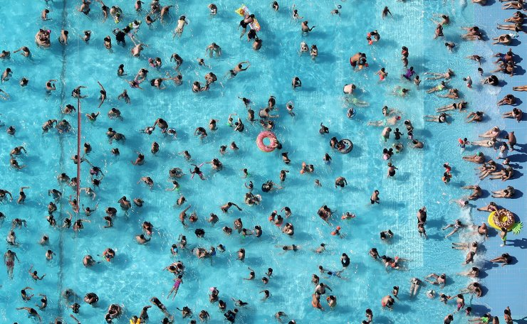 An aerial view showing people enjoying a sunny and hot day at the public outdoor pool 'Grugabad' in Essen, Germany, 24 July 2019. Germany experience a heat wave with temperatures up to 40 degrees Celsius. EPA