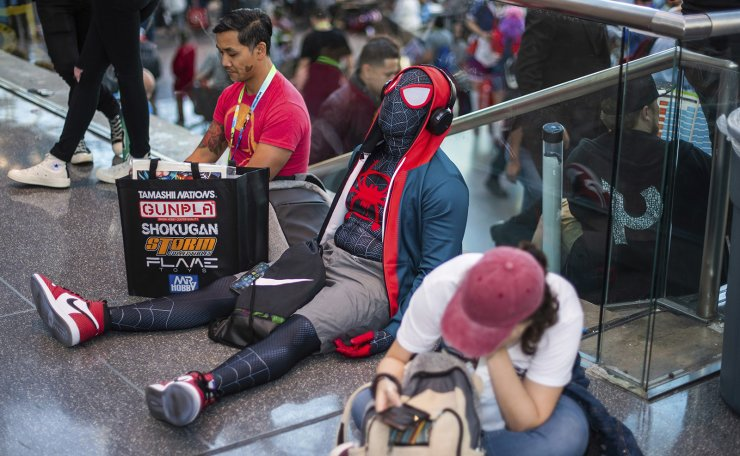 An attendee dressed as Spider-Man takes a break during New York Comic Con at the Jacob K. Javits Convention Center on Friday, Oct. 4, 2019, in New York. AP