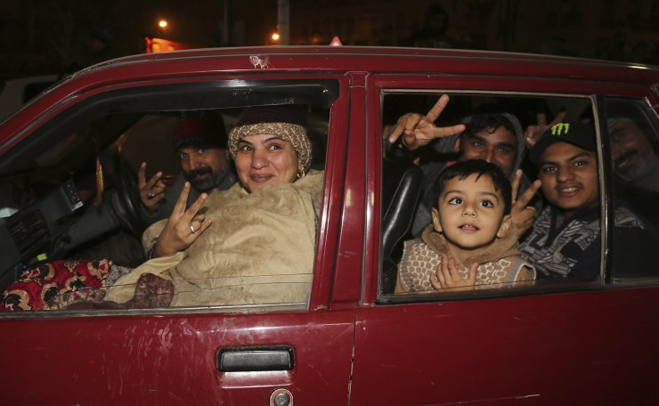 Pakistan family celebrate the new year in downtown of Lahore, Pakistan, Wednesday, Jan. 1, 2020. AP