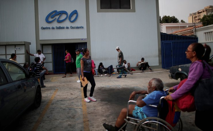 Patients with kidney disease wait with their relatives, for electricity to return, in front of a dialysis centre during a blackout in Maracaibo, Venezuela, April 13, 2019. Reuters