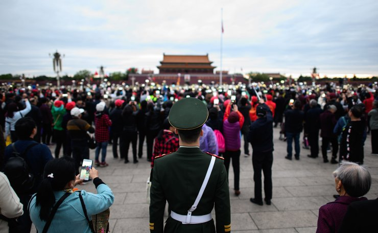 In this picture taken on April 8, 2019, a Chinese paramilitary policeman stands guard at Tiananmen square in Beijing. AFP