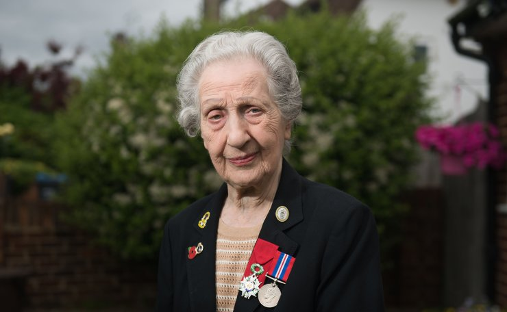 Veteran D-Day switchboard operator Marie Scott, 92, poses for a portrait wearing her WWII service medal (R) and her French Legion of Honour (Legion d'honneur) during an interview at her home in southwest London on May 31, 2019. - Marie Scott vividly recalls the horrifying sound of D-Day as she relayed orders down the line to the troops storming the Normandy beaches.  She was one of nine women transmitting critical messages back and forth between communications headquarters in England and the fighting in France, as the Allied invasion to liberate Western Europe began. AFP