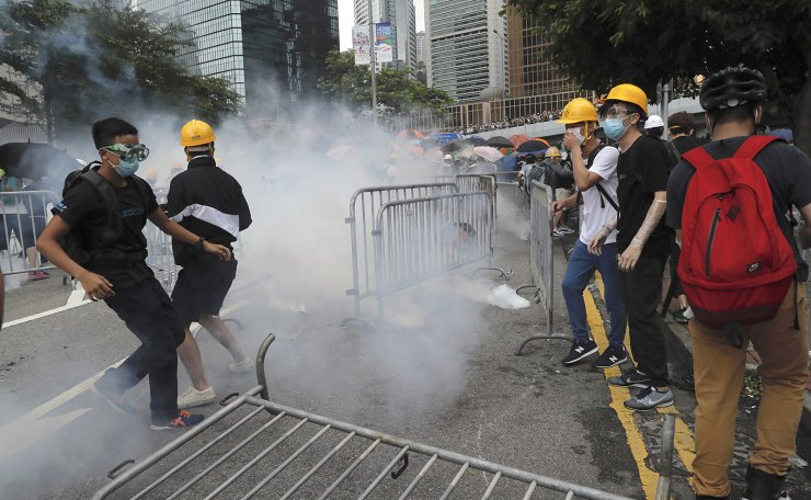 Protesters react to tear gas during a large protest near the Legislative Council in Hong Kong, Wednesday, June 12, 2019. AP