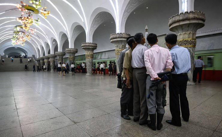 <span>Commuters read a newspaper while waiting for a train at a newsstand in a subway station in Pyongyang on June 19, 2019, ahead of a visit to the North Korean capital by Chinese President Xi Jinping on June 20. - Xi will be the first Chinese leader to visit Pyongyang in 14 years. AFP</span><br /><br />