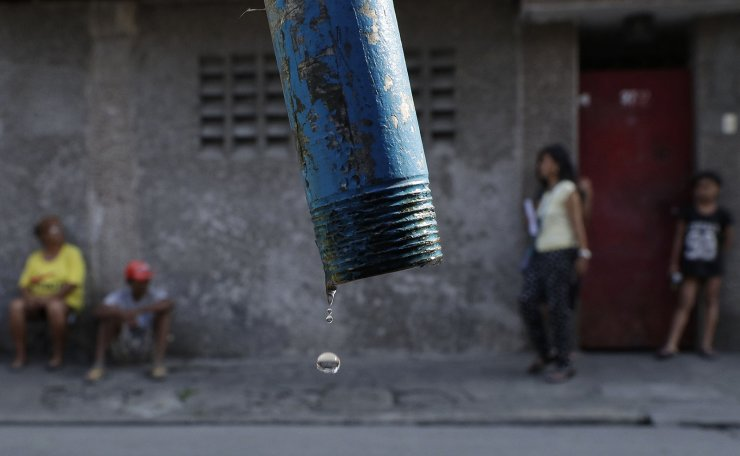 Water drops from a faucet as residents wait for trucks bearing water to return in Mandaluyong, metropolitan Manila, Philippines on Wednesday, March 13, 2019. Parts of metropolitan Manila are suffering from water shortage due to the continued dip of levels at the La Mesa dam as the country enters the dry season and the onset of El Nino which causes below normal rainfall conditions. AP