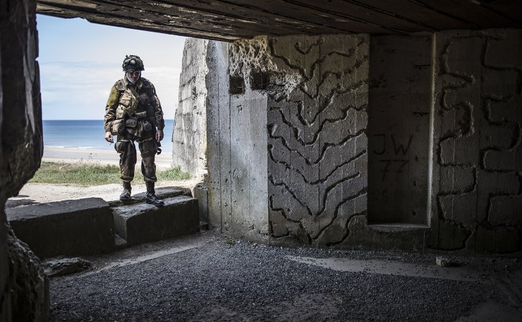 A history enthusiast dressed as a US paratrooper from WWII enters a German bunker overlooking Omaha Beach on the Normandy coast ahead of the 75th D-Day anniversary, in Colleville-sur-Mer, France, 03 June 2019. EPA