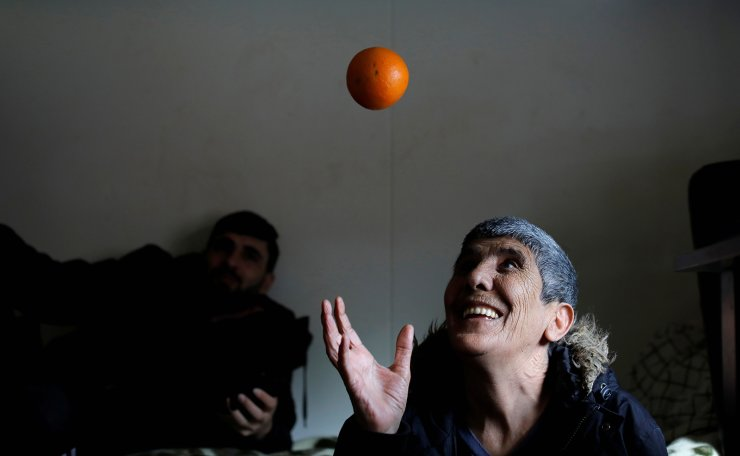 <span>Karim Azizi, 55, from Iran throws an orange in his room at Kaershovedgaard, a former prison and now a departure centre for rejected asylum seekers in Jutland, Denmark, March 26, 2019. Reuters</span><br /><br />