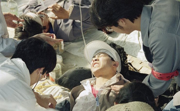 FILE - In this May 17, 1989 file photo, a striking Beijing University student is given first aid by medics at a field hospital in Tiananmen Square at Beijing, the fourth day of their hunger strike for democracy. AP