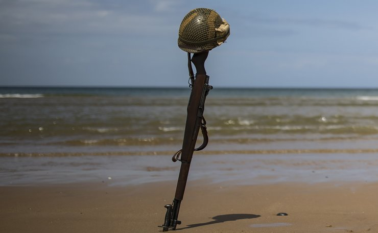 A US helmet sits top an M1 Guarand rifle replica stuck in the sand  on Omaha Beach on the Normandy coast ahead of the 75th D-Day anniversary, in Colleville-sur-Mer, France, 03 June 2019. EPA