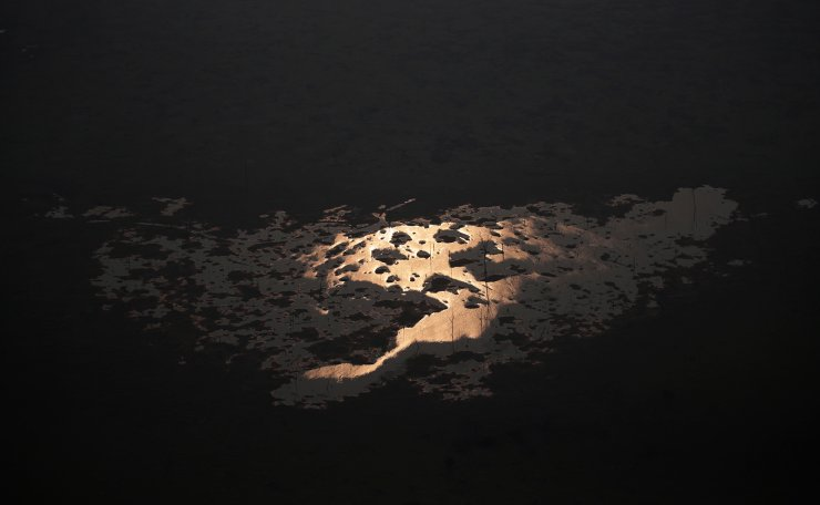 Sunlight is seen over the lake of Samuel Hydroelectric Dam in an area of the Amazon rainforest near Porto Velho, Rondonia State, Brazil, Brazil August 21, 2019. Reuters