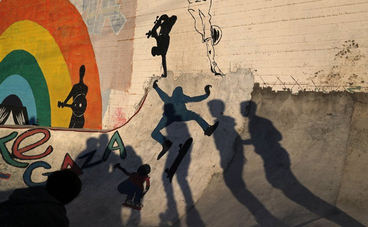 Members of Gaza Skating Team cast shadows as they practice their rollerblading and skating skills at the seaport of Gaza City March 8, 2019. Picture taken March 8, 2019. Reuters